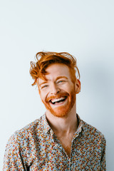 portraits of young redhead cool man