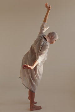 Puzzled woman performing strange dance