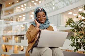 Joyful African Businesswoman Working In Office Building