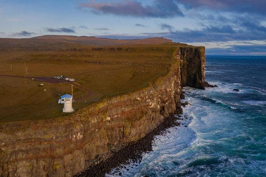 Lighthouse on Latrabjarg cliffs in Iceland. Aerial drone shot, september 2019