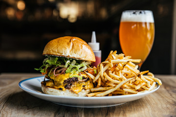 Double Cheeseburger with French Fries and a Beer