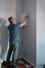 Workman installing air conditioner