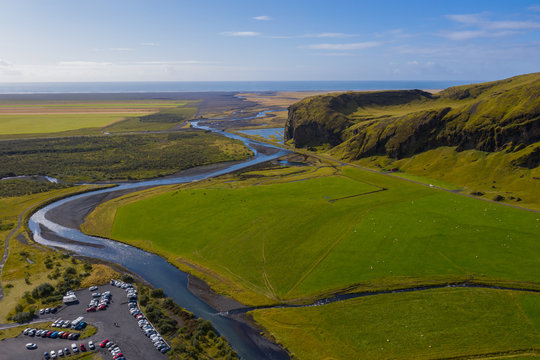 Beautiful lush green Landscape of Skoga river valley cascades near Skogafoss waterfall and Skogar end of Fimmvorduhals hiking trail. South Iceland, aerial drone view, september 2019