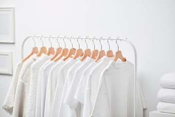 White shirts and tops on hangers