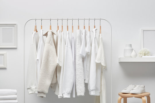 Interior of white cloakroom with rack