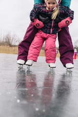 Family Lifestyle Winter Image of Child Learning to Skate