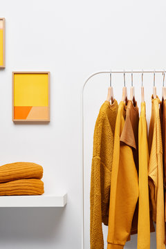Wardrobe with yellow clothes on rack