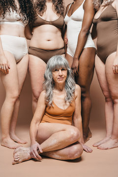 Long curly grey hair woman.
