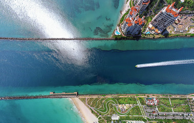 Aerial view of small boat crossing man-made canal, Miami, Florida, USA