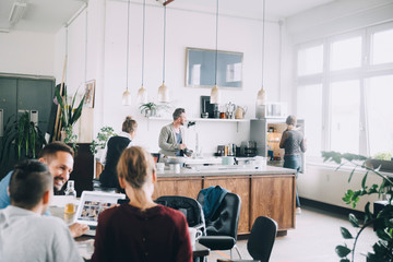 Creative male and female entrepreneurs working in office