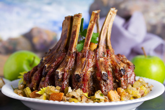 Crown roast of pork with apple and bread stuffing.
