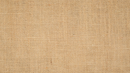 Hessian sackcloth burlap woven texture background  / cotton woven fabric background with flecks of...