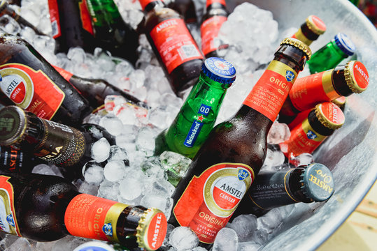 Valencia, Spain - October 12, 2019: Amstel beer bottles in a bucket with ice during a catering event.