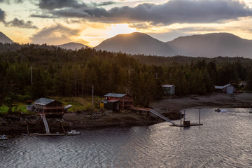 Fototapete - Beautiful Aerial View of homes near a historic town on the Ocean Coast during a dramatic stormy sunset. Taken in Ketchikan, Alaska, United States.