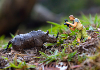 a toy photographer takes pictures of a toy animals
