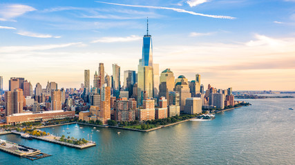 Wall Mural - Aerial view with Lower Manhattan skyline at sunset viewed from above Hudson River