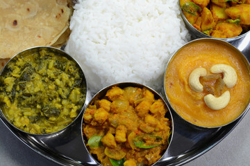 Indian food thali with rice, roti and curry dishes