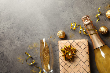 Fotobehang - Flat lay composition with bottle of champagne for celebration on grey stone background. Space for text
