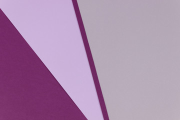 An abstact background of gray, lilac and viotel lines overlapping each other