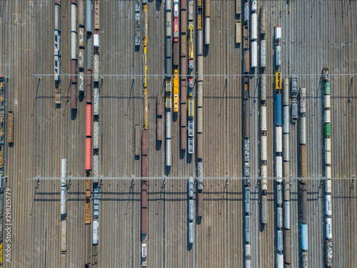 Aerial view of freight train wagons on large railway track