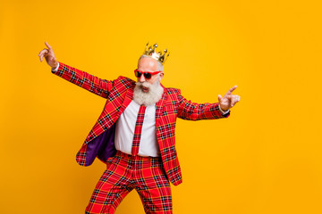 Photo of cool look grandpa white beard vip guy dancing strange youth moves little drunk wear crown sun specs plaid red blazer tie pants outfit isolated yellow color background Fototapete