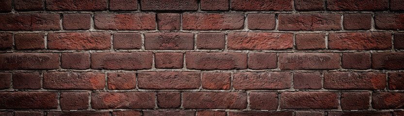 Red brick wall close-up wide texture. Old rough orange brickwork widescreen background