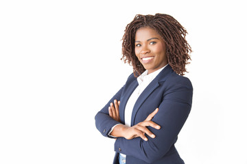 Fototapeta Happy successful female professional smiling at camera. Young African American business woman with arms crossed standing isolated over white background. Confident businesswoman concept obraz