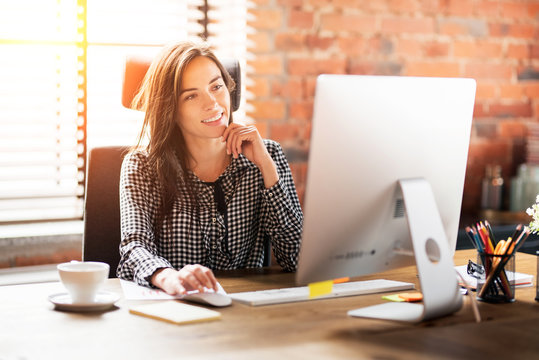 Woman working with computer at office