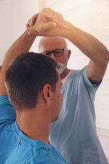 Chiropractic / Osteopathy treatment, elbow jont pain. Physiotherapy for male patient, sport injury recovery , Kinesiology
