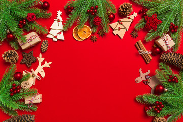Wall Mural - Top view of Christmas decorations on red background. New Year holiday concept with copy space