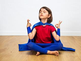 proud superhero child practicing yoga and meditation for zen humour