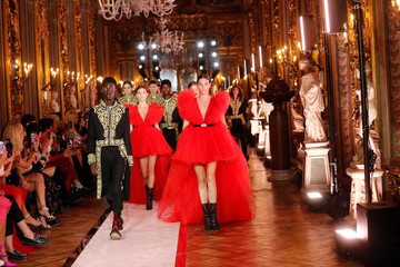 Models on the catwalk at the end of the show to present creations of designer Giambattista Valli and fast-fashion giant H&M in Rome, Italy october 24, 2019