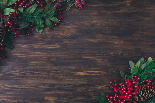 Top above high angle view photo of christmas object composition of fir tree branches berries pine cone lay on wooden brown surface background