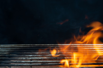 Poster Firewood texture Empty flaming charcoal grill with open fire, ready for product placement., bbq and party. Black copyspace