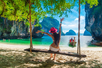 Printed kitchen splashbacks Beige Happy woman traveler in bikini on swing joy fun beautiful nature scenic landscape tropical beach island, Leisure tourist travel Krabi Phuket Thailand summer holiday vacation, Tourism destinations Asia