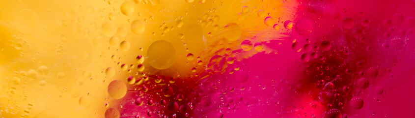 Soft focus abstract background with circles and balls. Bright yellow, red, pink colors. Horizontal...