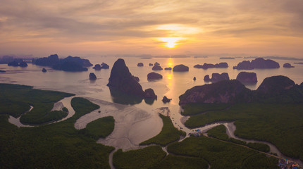 Recess Fitting Gray traffic Aerial top view of Samet Nangshe, mountain valley hills, and tropical green forest trees at sunset with Andaman sea in Phang Nga Bay in summer, Thailand in travel trip. Natural landscape background.