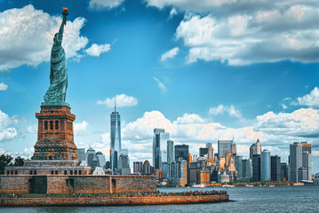 Statue of Liberty on Liberty Island on the background New York Harbor and New York City. Fotobehang