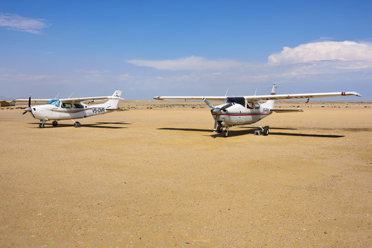 SWAKOPMUND, NAMIBIA - JAN 31, 2016: Cessna airplane takes off on the small airport near Swakopmund. Popular tourist attraction in Namibia - flight safaris above Namib desert