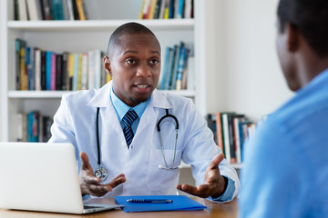 African american doctor has bad news for male patient