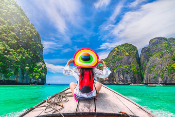Colorful summer lifestyle traveler woman joy fun relaxing on boat at sunny beach Maya bay Krabi, Tourist girl on holiday vacation trip, Travel Phuket Thailand, Tourism beautiful destination place Asia Fototapete