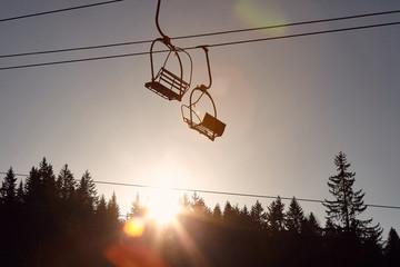 Fototapeta winter mountain landscape with with modern ski lift chair. .skiing lift mechanism on winter . obraz