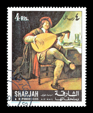 Cancelled postage stamp printed by Sharjah, that shows painting Self-Portrait as a Lute Player, by Jan Steen, circa 1967.