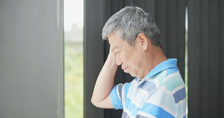 elder man look through window