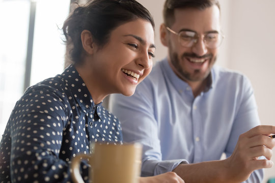 Diverse office workers couple having a coffee break