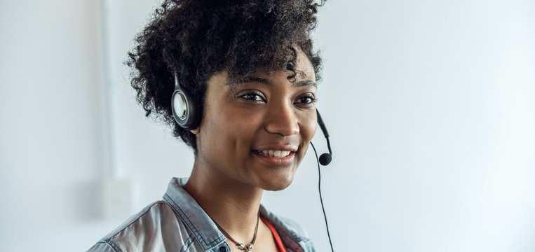 Close-up of young businesswoman wearing headset