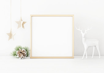 Square christmas poster mockup with golden frame, pine cone, star garland and deer on white wall background. 3D rendering, illustration.