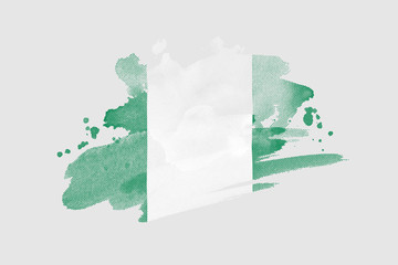 National flag of Nigeria. Stylized Nigerian flag with watercolor halftone effect on plain background