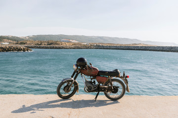 View of old motorcycle on the sea shore, Nazare, Portugal