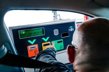 Man paying road toll
